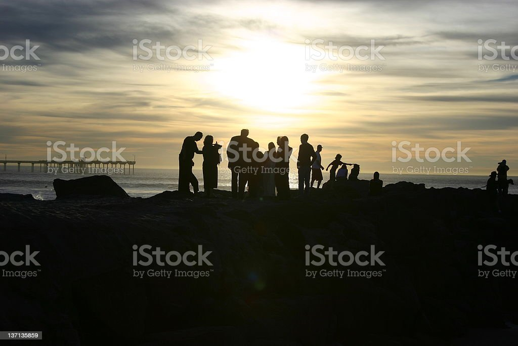 People gather at beach during California wildfires royalty-free stock photo