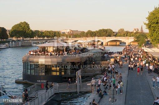 Paris, France - Aug 30, 2019: People gather at the Seine River in Paris, France.