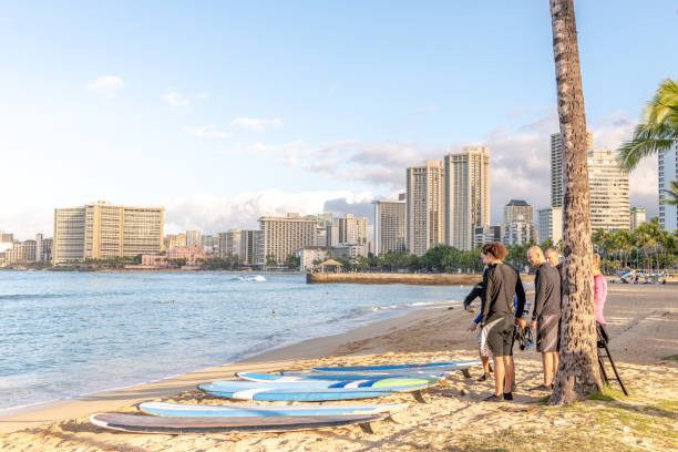 People gather for surfing lesson at Waikiki Beach stock photo