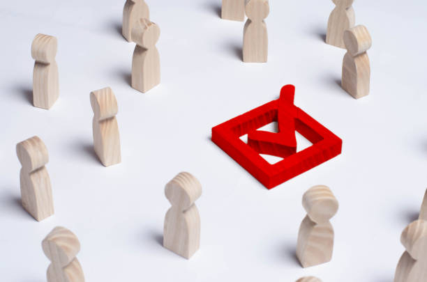 People gathered around the checkbox on a white background. People make a group choice. Democratic elections, collective decision and choice, referendum. Concept forum of people. Red Check mark. stock photo