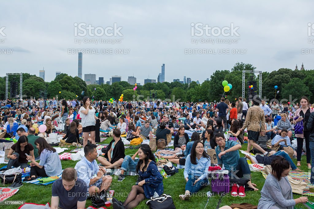 People gathered for the free outdoor orchestra performance of th stock photo