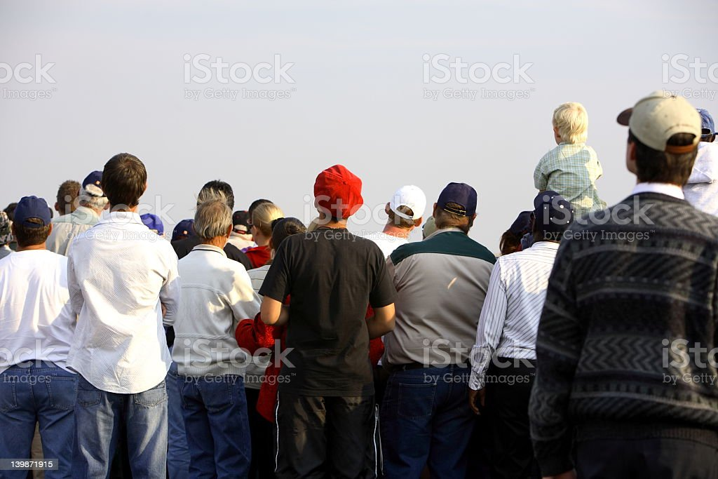 People gathering around for news stock photo