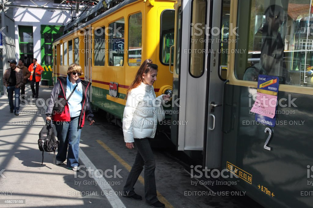 People getting into a cable car at Lauterbrunnen railway station royalty-free stock photo