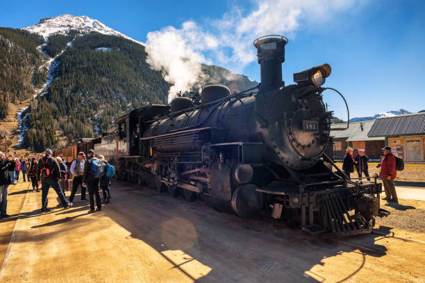 People getting of the Durango to Silverton Narrow Gauge Train in Silverton Silverton, Colorado, USA - October 15, 2018 : People getting of the Durango to Silverton Narrow Gauge Train in Silverton. narrow stock pictures, royalty-free photos & images