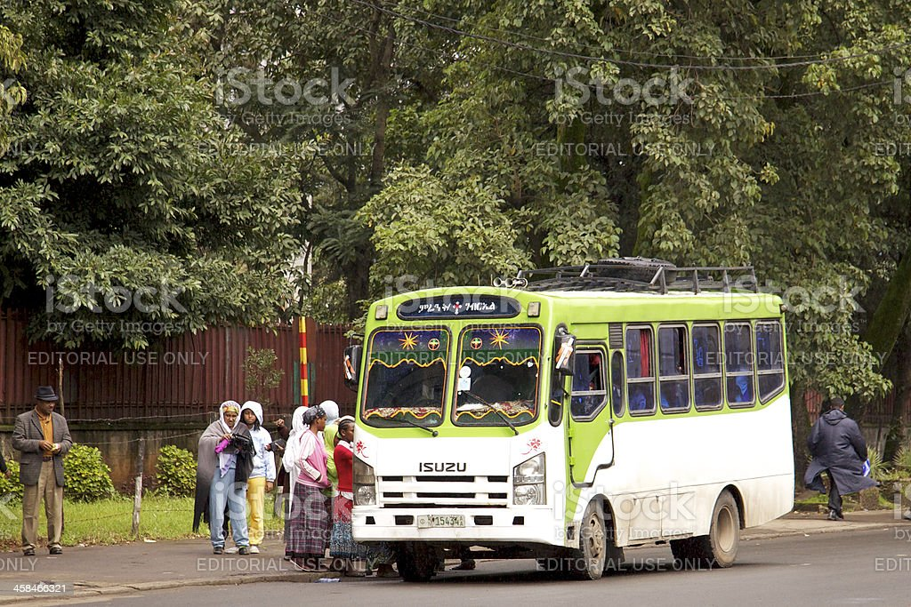 People getting on bus royalty-free stock photo