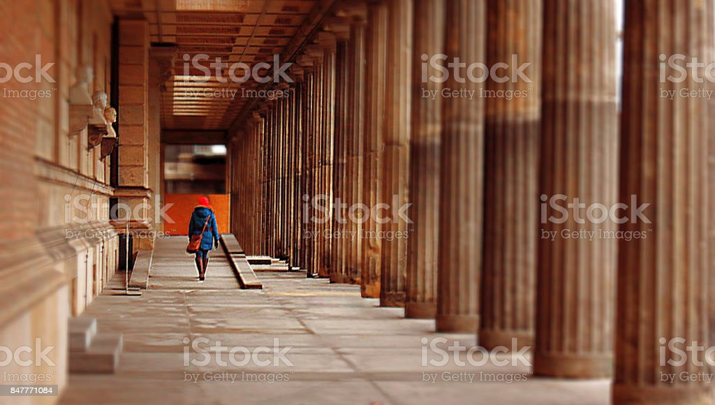 People girl woman cityscape building walkway pavement pillars perspective urban stock photo
