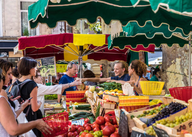 people go shopping at the food market in Aix en provence. The local farmer offer their fresh vegetables and fruits at the market stock photo