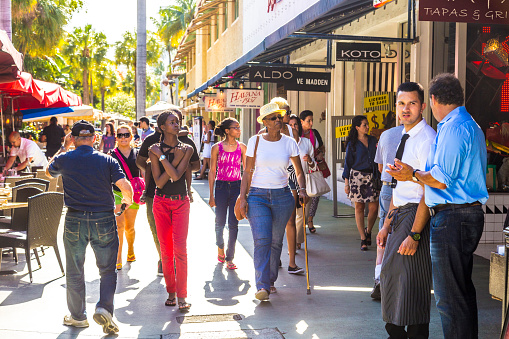 People Go Shopping In The Afternoon Sun In Lincoln Road Stock Photo - Download Image Now