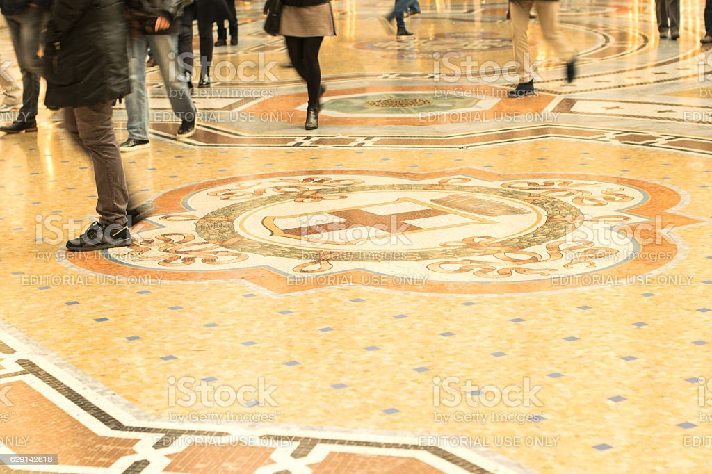 People go to the beautiful mosaic floor stock photo