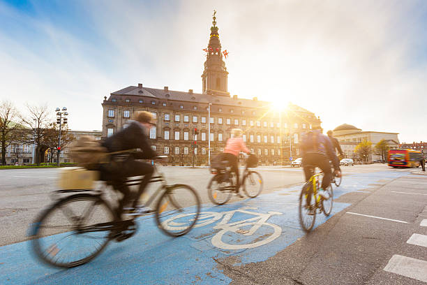 people going by bike in copenhagen - denmark stock photos and pictures