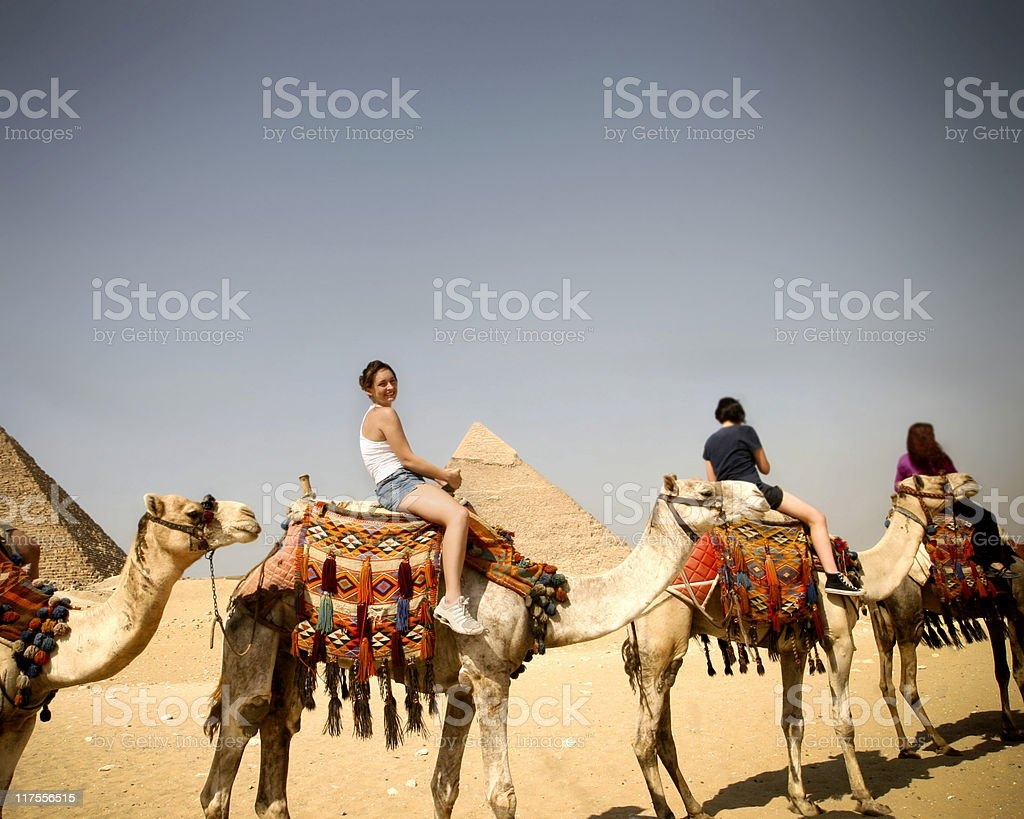 People going for a camel ride in Egypt stock photo