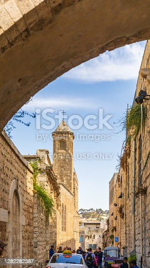 istock People going to the campanile on the Via Dolorosa street in Jerusalem 1282282387