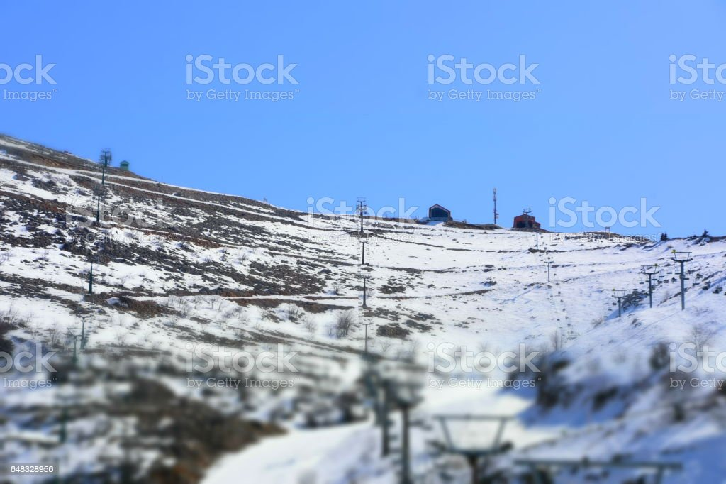 People going up hill for ski stock photo