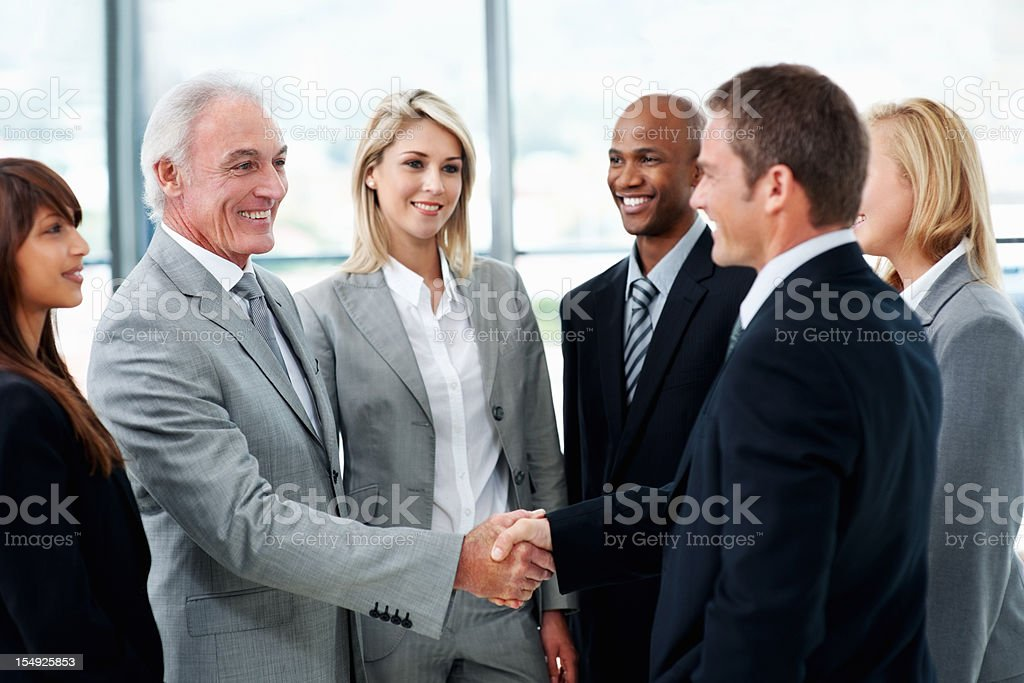 People greeting each other in a meeting stock photo more pictures people greeting each other in a meeting royalty free stock photo m4hsunfo