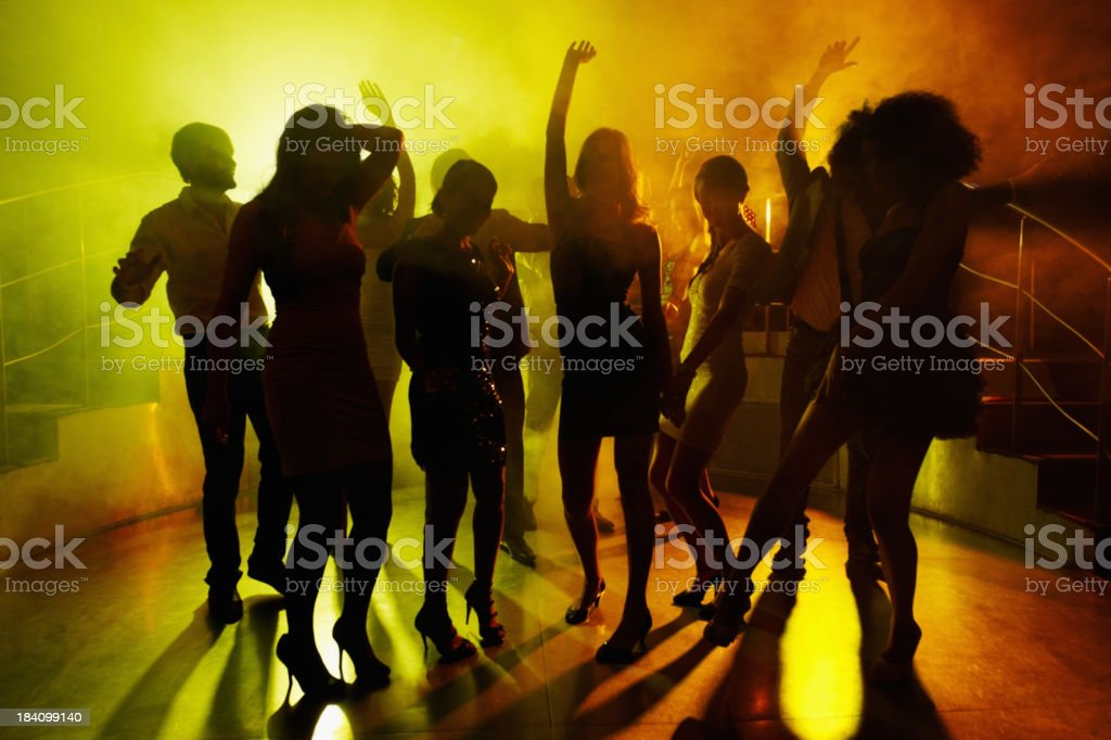 People grooving on dance floor at a night club royalty-free stock photo