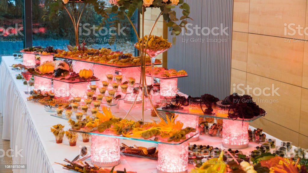 People Group Catering Buffet Food Indoor In Luxury Restaurant With