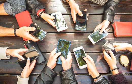 istock People group having addicted fun together using smartphones - Detail of hands sharing content on social network with mobile smart phones - Technology concept with millennials online with cellphones 952414660
