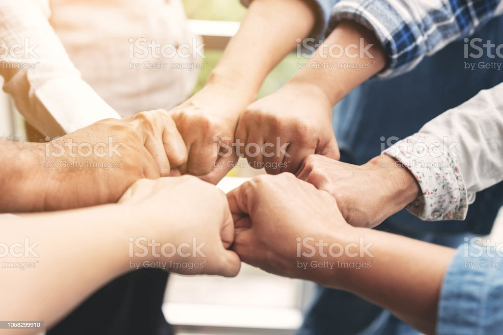 People hand assemble as a connection meeting teamwork concept. Group...