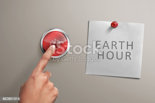 People hand with Earth hour note turning off electrical equipment on the wall