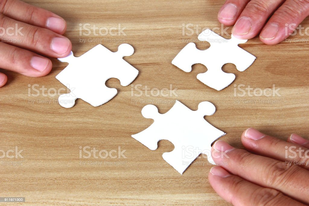 People hands connecting jigsaw puzzle stock photo