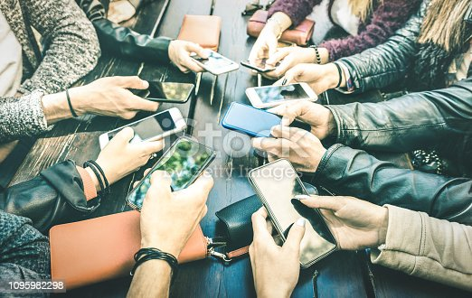 911294484istockphoto People hands having addicted fun together using smartphone - Millenial sharing content on social media network with mobile smart phones - Technology concept with millennials online on cellphone device 1095982298