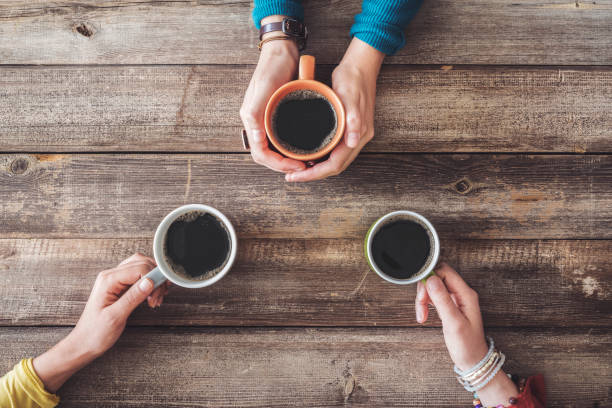People hands holding a cup of coffee stock photo