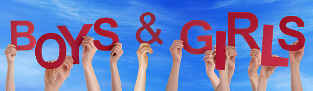 People Hands Holding Red Word Boys Girls Blue Sky stock photo