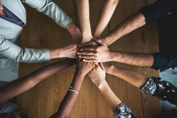 people hands together partnership teamwork - groupe organisé photos et images de collection