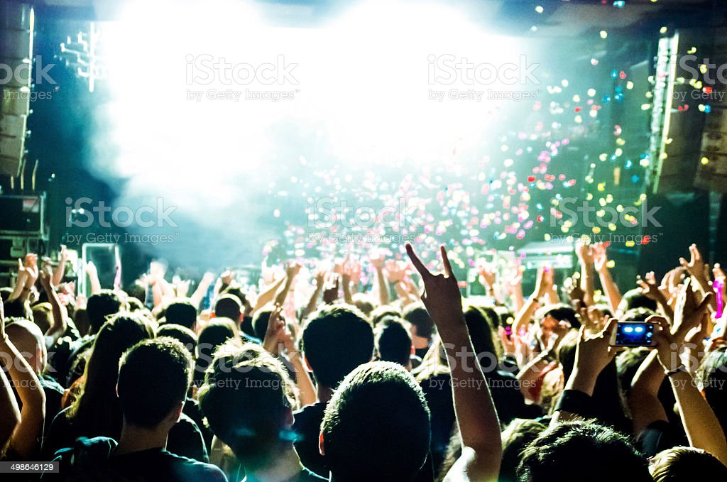 people hands up music concert live explosion rock dance light stock photo