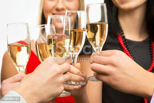 istock People hands with crystal glasses full of champagne 158394731