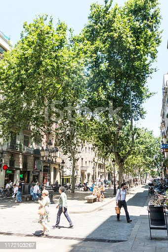 BARCELONA - JUNE 20, 2019: People hanging out and walking around El Passeig del Born, a rectangular open space which stretches from the Santa Maria del Mar church to Placa Comercial