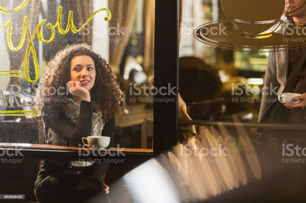 People hanging out in coffee shop stock photo