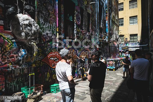 488380038 istock photo People hanging out on Hosier Lane on November 10, 2018. It's one of the tourist attraction in Melbourne to see graffiti on the wall. 1175048615