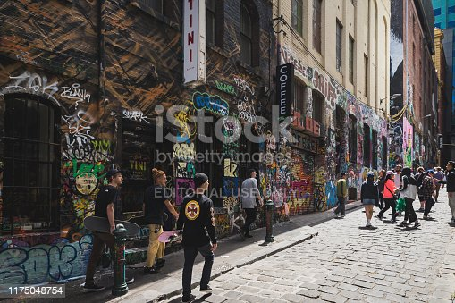 488380038 istock photo People hanging out on Hosier Lane on November 10, 2018. It's one of the tourist attraction in Melbourne to see graffiti on the wall. 1175048754