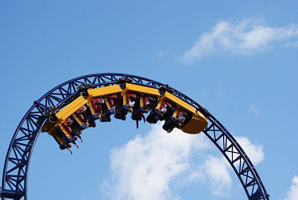 people hanging upside down on the roller coaster track - liseberg bildbanksfoton och bilder