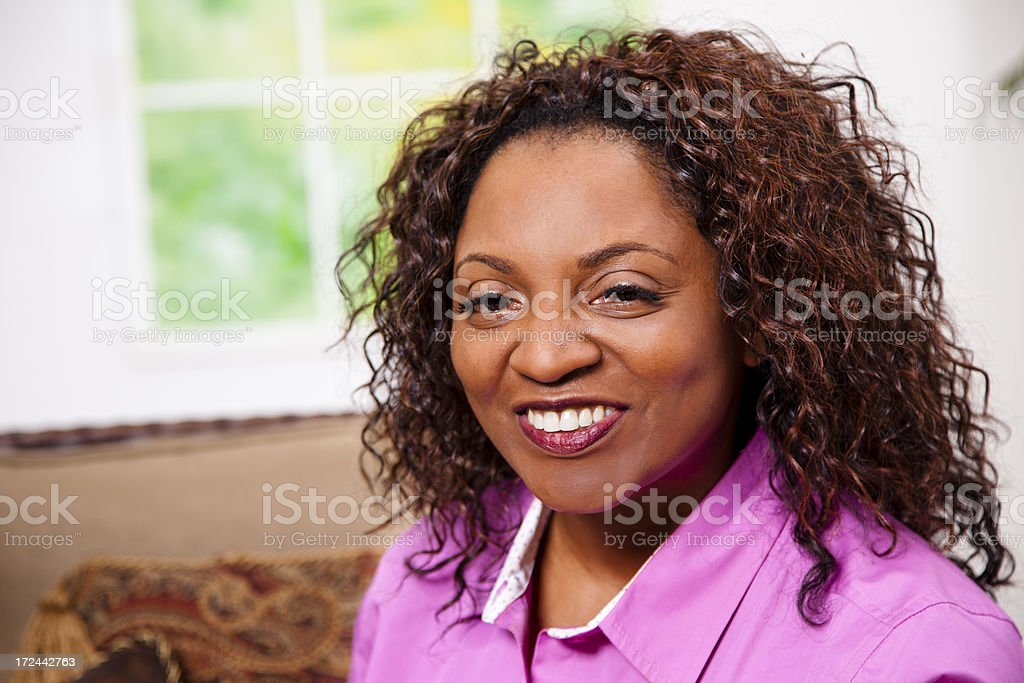 People:  Happy smiling mid-adult woman, looking at camera royalty-free stock photo