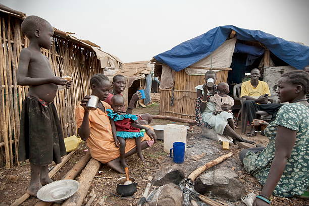 people have breakfast in displaced persons camp, juba, south sudan. - sudan stock photos and pictures
