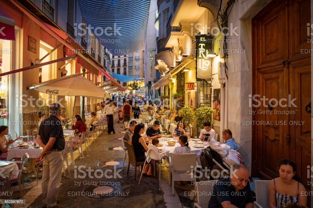 People have dinner in downtown Malaga Andalusia Spain stock photo