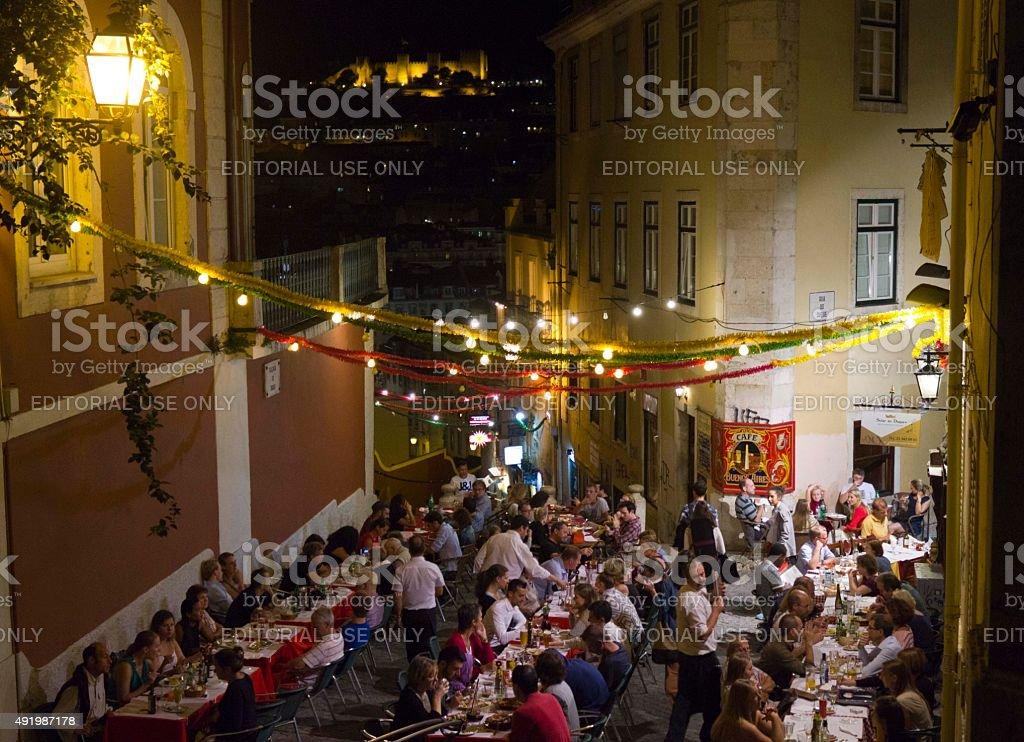 People having dinner outdoor in Calcada do Duque in Lisbon stock photo