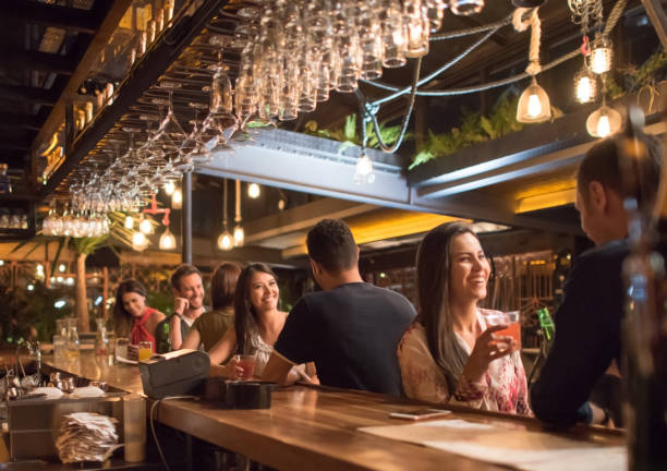People having drinks at a bar stock photo