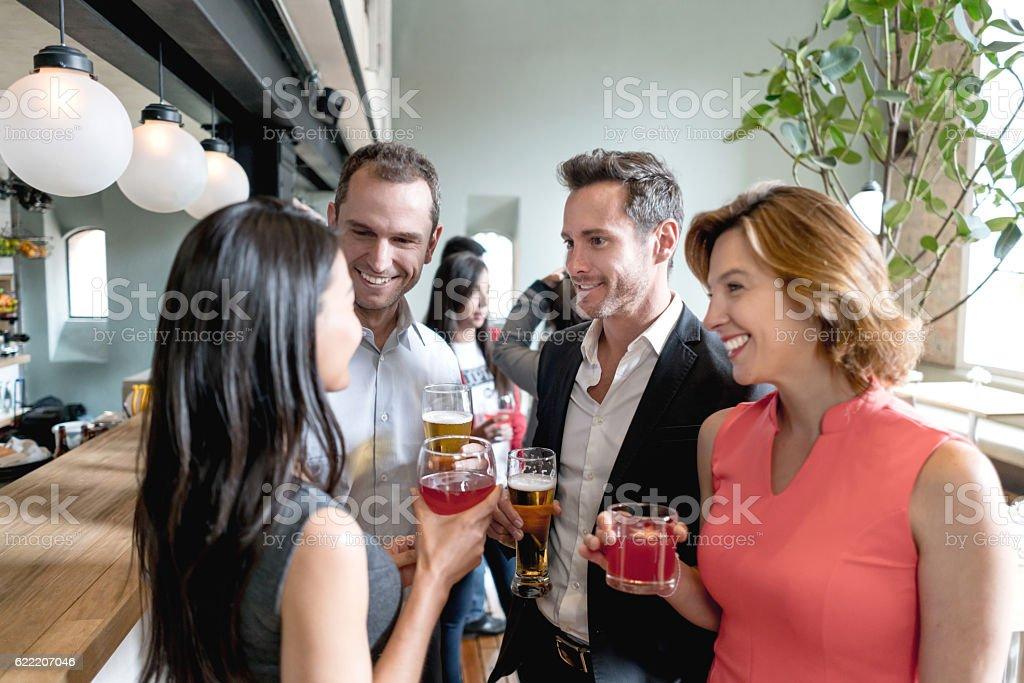 People having drinks at a restaurant - foto de stock