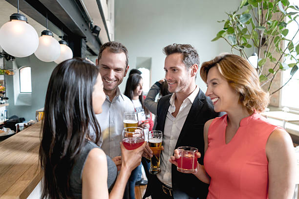 people having drinks at a restaurant - happy hour stock photos and pictures