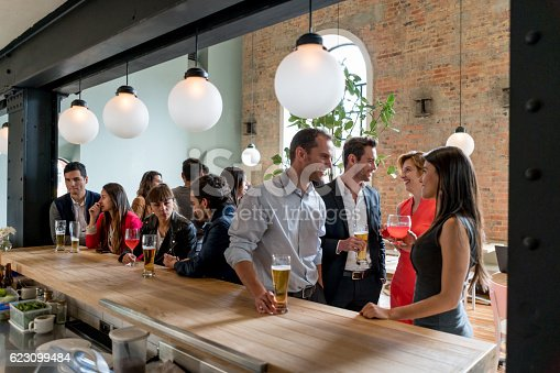 istock People having drinks at a restaurant 623099484