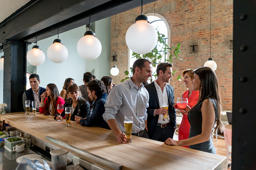 Group of business people having drinks after work at a restaurant