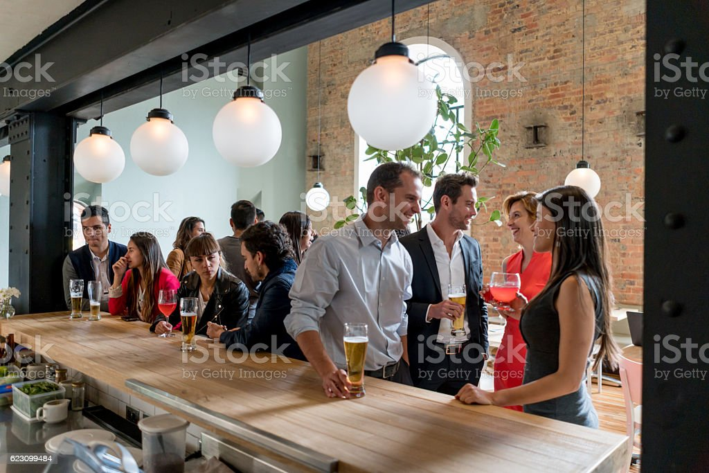 People having drinks at a restaurant stock photo