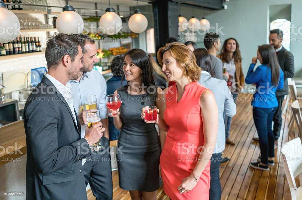 People having drinks at the bar stock photo