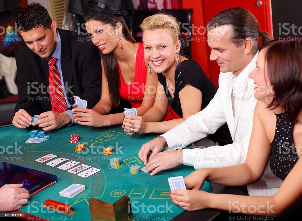 People having fun at the Blackjacks table in casino. royalty-free stock photo