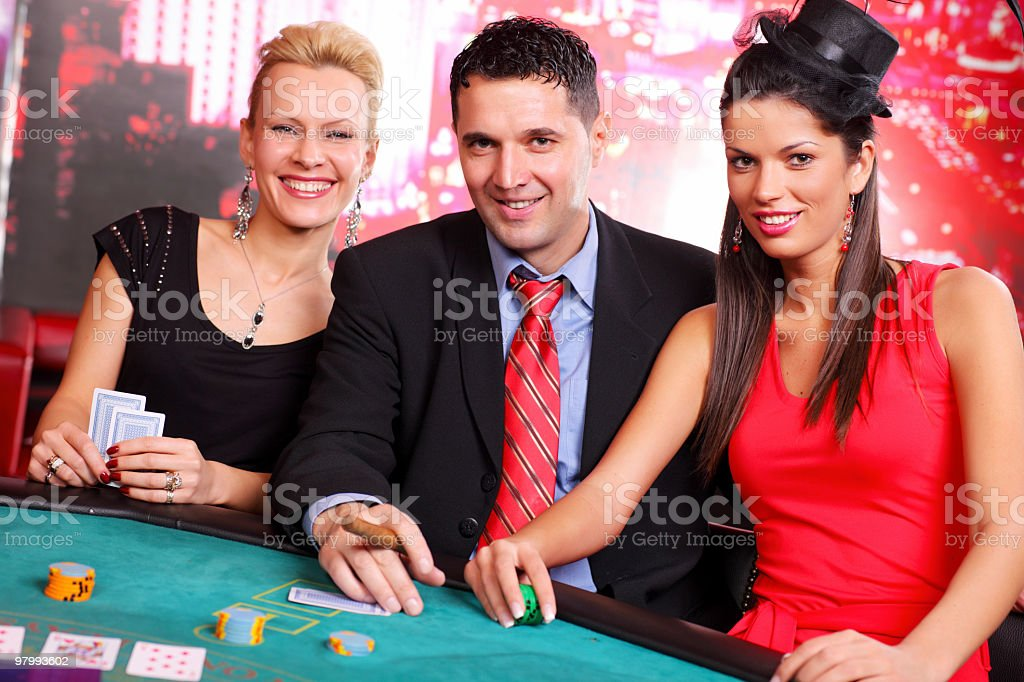 People having fun at the Blackjacks table in casino. royalty-free stock photo