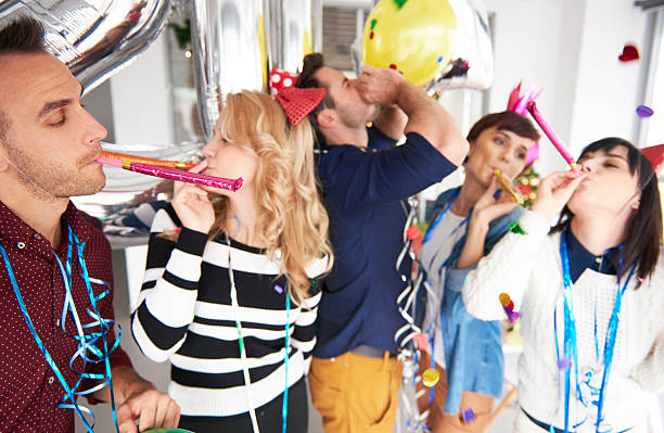 People having fun at the office party stock photo