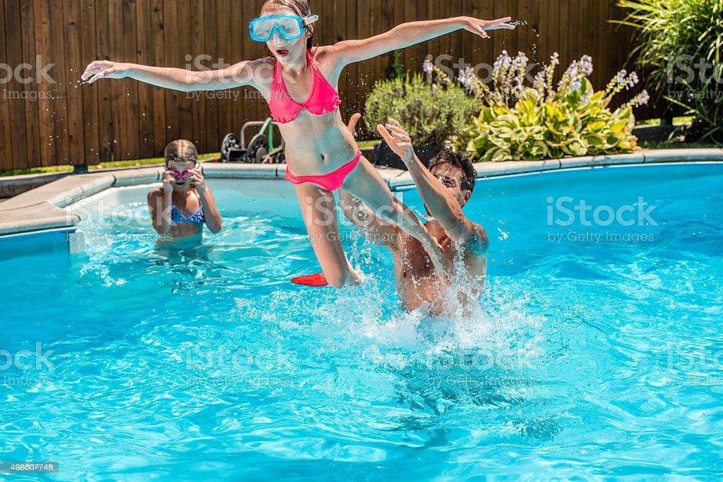 People Having Fun In Swimming Pool Royalty Free Stock Photo